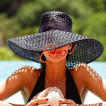 Travel Hack: How To Pack a Hat in Your Suitcase