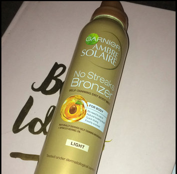 Photo of Garnier Ambre Solaire No Streaks Bronzer Self-Tanning Dry Face Mist uploaded by Kenzie R.