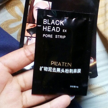 Photo of Genuine by Tarad Siam PILATEN blackhead remover,Tearing style Deep Cleansing purifying peel off the Black head,acne treatment,black mud face mask 60g uploaded by Veronica P.