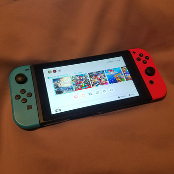 Photo of Nintendo Of America - Switch 32GB Console - Neon Red/neon Blue Joy-con uploaded by Acacia D.