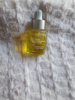 Clarins Santal Face Treatment Oil uploaded by Claudia O.