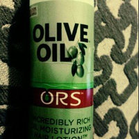 Organic Root Stimulator Olive Oil Moisturizing Hair Lotion uploaded by dunia a.