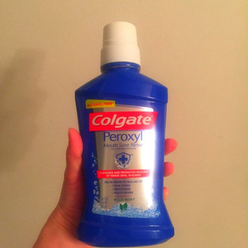 Photo of Colgate Peroxyl Mouth Sore Rinse, Mild Mint, 16.9 oz uploaded by Jennifer R.