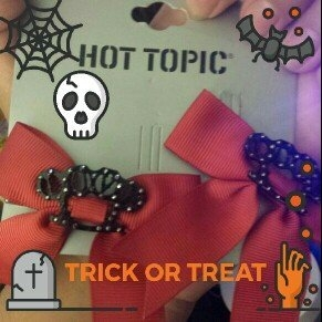 Hot Topic Red Love Brass Knuckles Ribbon Bow Hair Clips 2 Pack uploaded by Angela A.