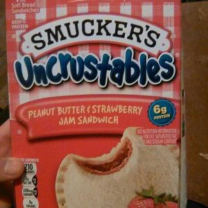 Smucker's Uncrustables Peanut Butter & Strawberry Jam Sandwich uploaded by Abigail G.