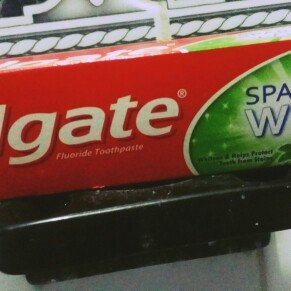 Photo of Colgate base Colgate Toothpaste Sparkling White Mint Zing 4.6 OZ uploaded by Jassia P.