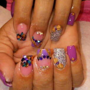 Photo of Bundle Monster 5 Nail Art Manicure Wheels W 3D Designs Glitters Rhinestones Beads uploaded by Maria O.