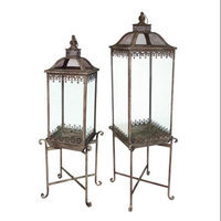 Melrose Set of 2 English Garden Elevated Iron and Glass Garden Lanterns on Stands