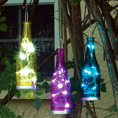 Smart Solar Outdoor Lighting. Fiesta Hanging Glass Bottle LED Light with Embossed Effect (3-Pack)