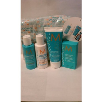 Moroccanoil 4 Piece Travel Kit (Includes 2.4 Oz Shampoo, 2.4 Oz Conditioner, Moroccanoil Treatment 25ml, Curl Defining Creme 75ml, Travel Bag)