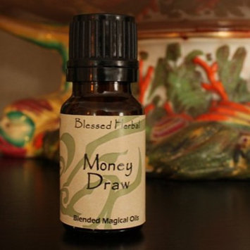 Blessed Herbal Money Draw Oil