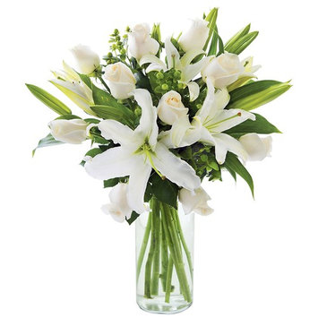 KaBloom Sweet Serenity Roses & Lilies Bouquet: 10 White Roses and 5 White Oriental Lilies Accented with Green Hypericum Berries and Lush Greens with Vase [With Vase]