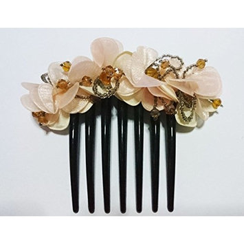 French twist hair comb Ornamented along the top of the heading with Flowers Nude color made fabric